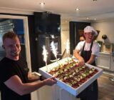 Crew presenting cake